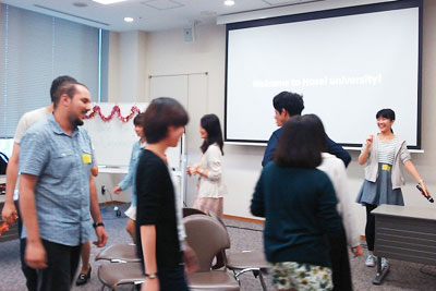 A scene of a welcome reception held by the Faculty of Intercultural Communication: the reception warmed up with musical chairs