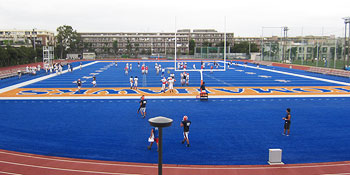 Players training on the bright colored ground dedicated to the Hosei Football team