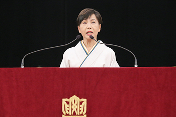 President Tanaka delivering her speech